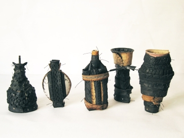 """Tire Jars (Small)"" 2013. Bicycle tires, innertubes, wood Approx. 12""x5""x4"""