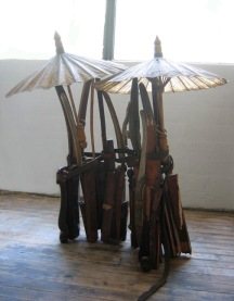 """Vietnam"" 2010. Wood, furniture parts, leather, paper parasols. 48""x32""x20"""