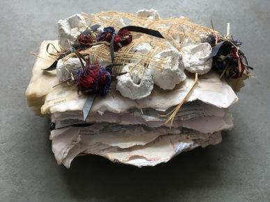 Dustball Rosebud 2018 Sensitive documents sealed into a wax folder, plaster, burlap, thread 5 x 11 x 10 in.