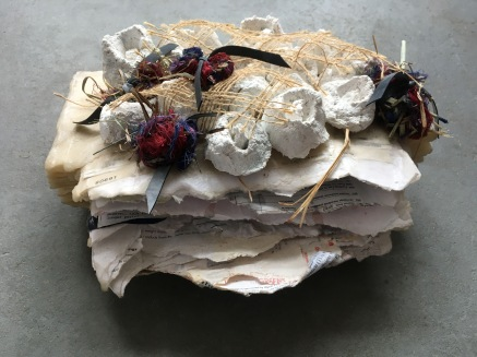 Dustball Rosebud 2018 Sensitive documents sealed into a wax folder, plaster, burlap, thread 5 x 11 x 10 in.